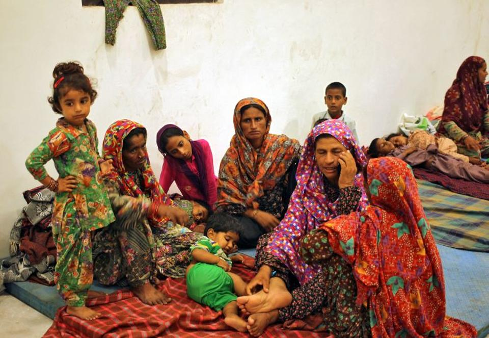 Villagers sit inside a relief camp after they evacuated their village near the border with Pakistan in Ranbir Singh Pora, southwest of Jammu, September 30, 2016