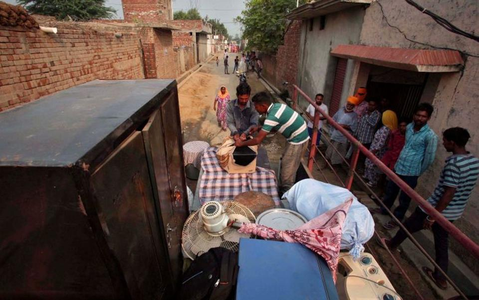 Villagers load their belongings onto a tractor trolley to move to a safer place, in the Pul Kanjari village, near the Wagah border in Punjab, India, September 30, 2016