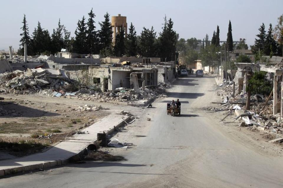 Damaged buildings like the ones seen in a photograph of al-Rai, a town in northern Aleppo, are evidence of a mounting air and ground war which continues to ravage country. [Reuters]