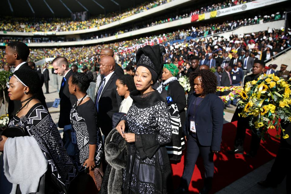 Family members arrive as Winnie Madikizela-Mandela coffin is brought into Orlando stadium in Soweto, South Africa, April 14, 2018.