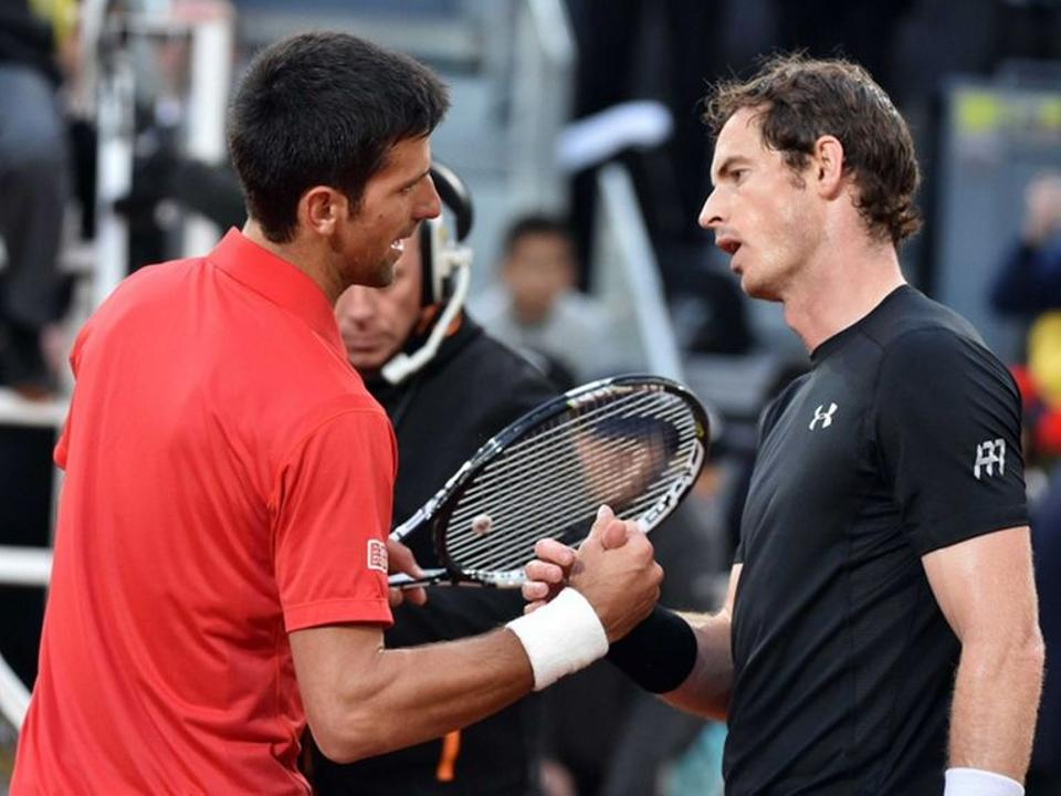 Novak Djokovic shakes Andy Murray's hand after beating him at the 2016 Madrid Open finals.