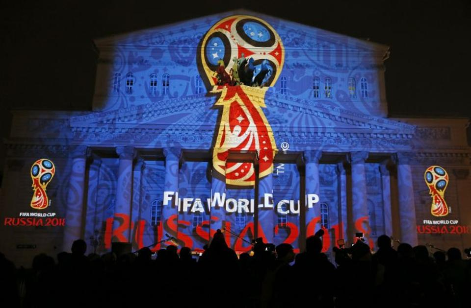 A light installation showing the official logotype of the 2018 FIFA World Cup during its unveiling ceremony at the Bolshoi Theater building in Moscow, Russia