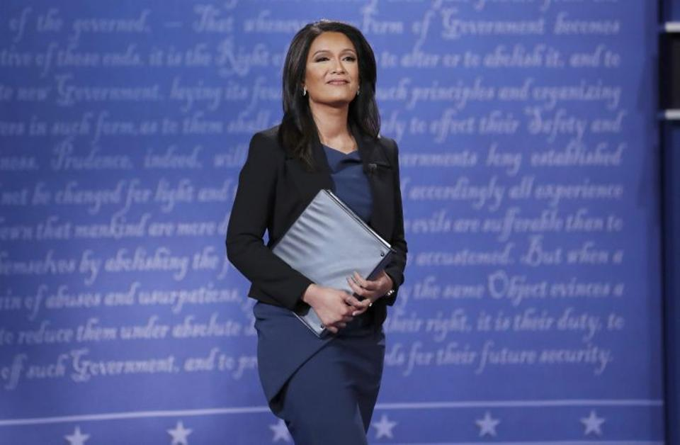 Moderator Elaine Quijano arrives on the stage at the start of the debate between Democratic US vice presidential nominee Senator Tim Kaine and Republican US vice presidential nominee Governor Mike Pence in Virginia. Source: Reuters
