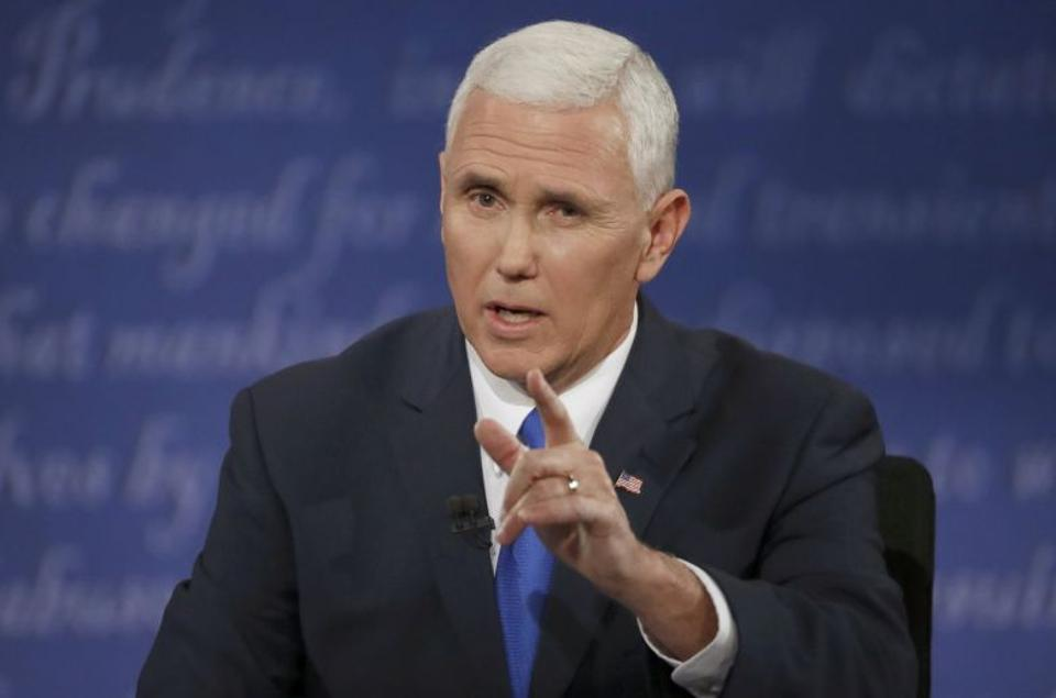 Republican US vice presidential nominee Governor Pence discusses an issue during his vice presidential debate with Democratic US vice presidential nominee Senator Kaine at Longwood University in Farmville, Virginia. Source: Reuters