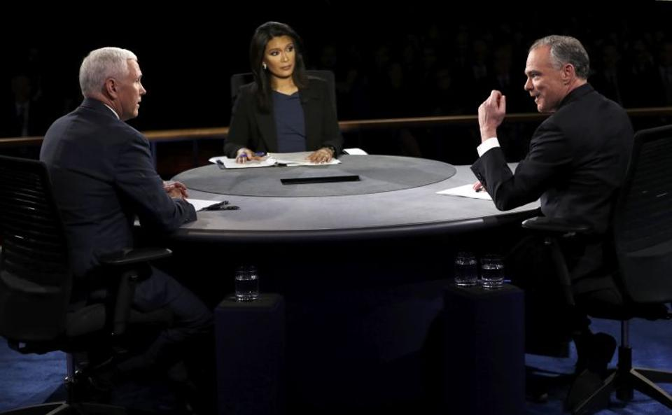 Democratic US vice presidential nominee Senator Tim Kaine and Republican US vice presidential nominee Governor Mike Pence debate as moderator Elaine Quijano looks on. Source: Reuters