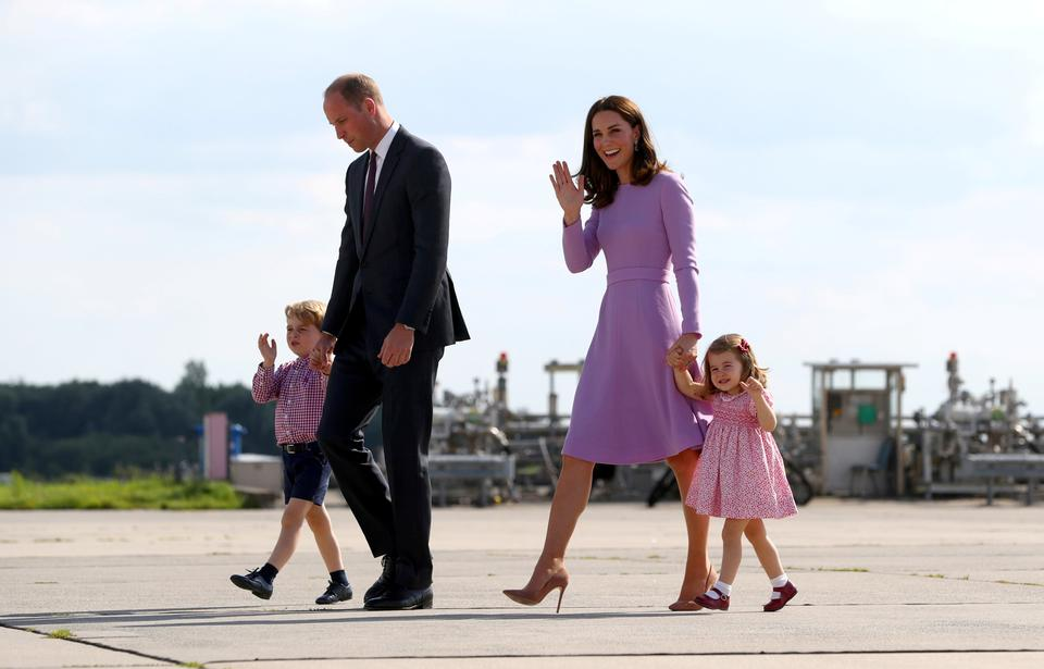 Britain's Prince William, the Duke of Cambridge, his wife Princess Catherine, the Duchess of Cambridge, Prince George and Princess Charlotte walk at the airfield in Hamburg Finkenwerder, Germany, on July 21, 2017.