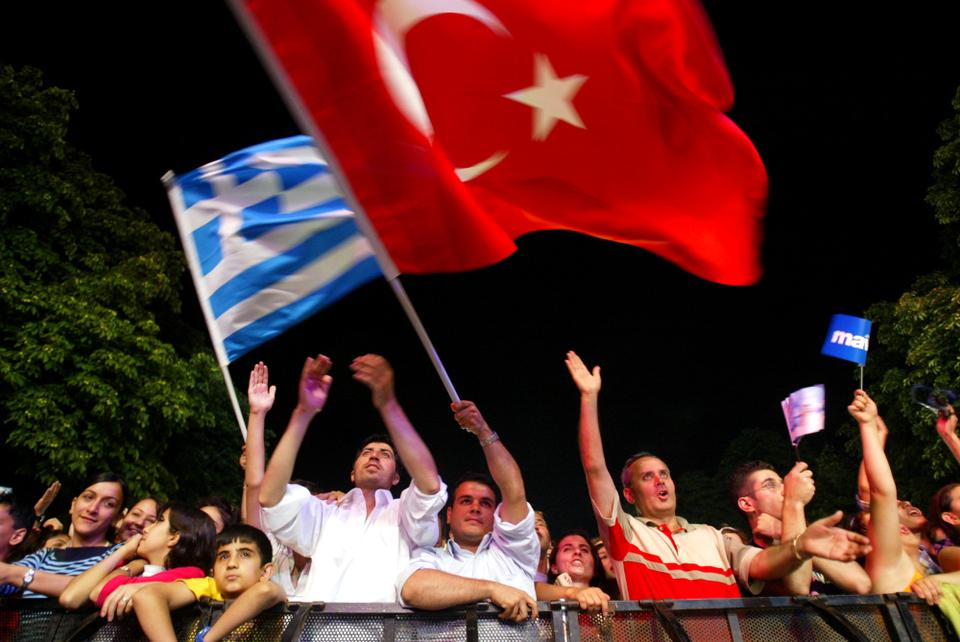 Turks and Greeks have lived peacefully for centuries, seen in this July 7, 2004 file photo as fans wave their national flags in Istanbul, Turkey, during a pop concert.