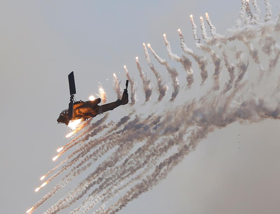The Turkish-made military attack helicopter, T-129 ATAK, fires at high velocity in a military drill in Turkey.