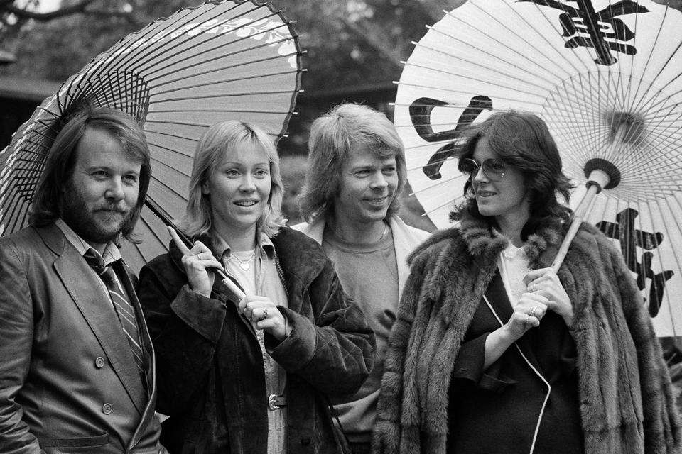 In this March 14, 1980, file photo, the four members of the Swedish pop group ABBA hold Japanese oil paper parasols in a light rain in the Japanese garden of their hotel in Tokyo.