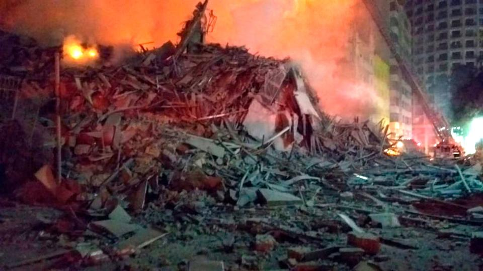 This photo released by the Sao Paulo Fire Department, shows debris of a building that was engulfed by a fire and collapsed, in Sao Paulo, Brazil, Tuesday, May 1, 2018. A burning building in downtown Sao Paulo has collapsed as firefighters worked to put out a fire that began in the middle of the night.
