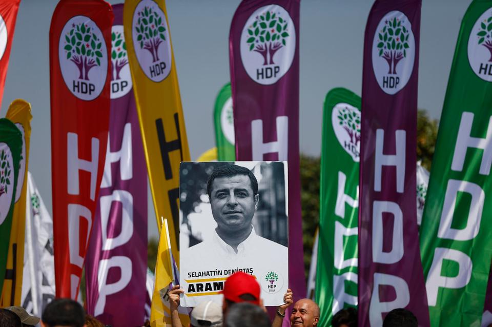 A demonstrator holds up a poster of Selahattin Demirtas, the jailed former co-leader of the HDP (Peoples' Democratic Party), during a May Day rally in Istanbul, Turkey, May 1, 2018.