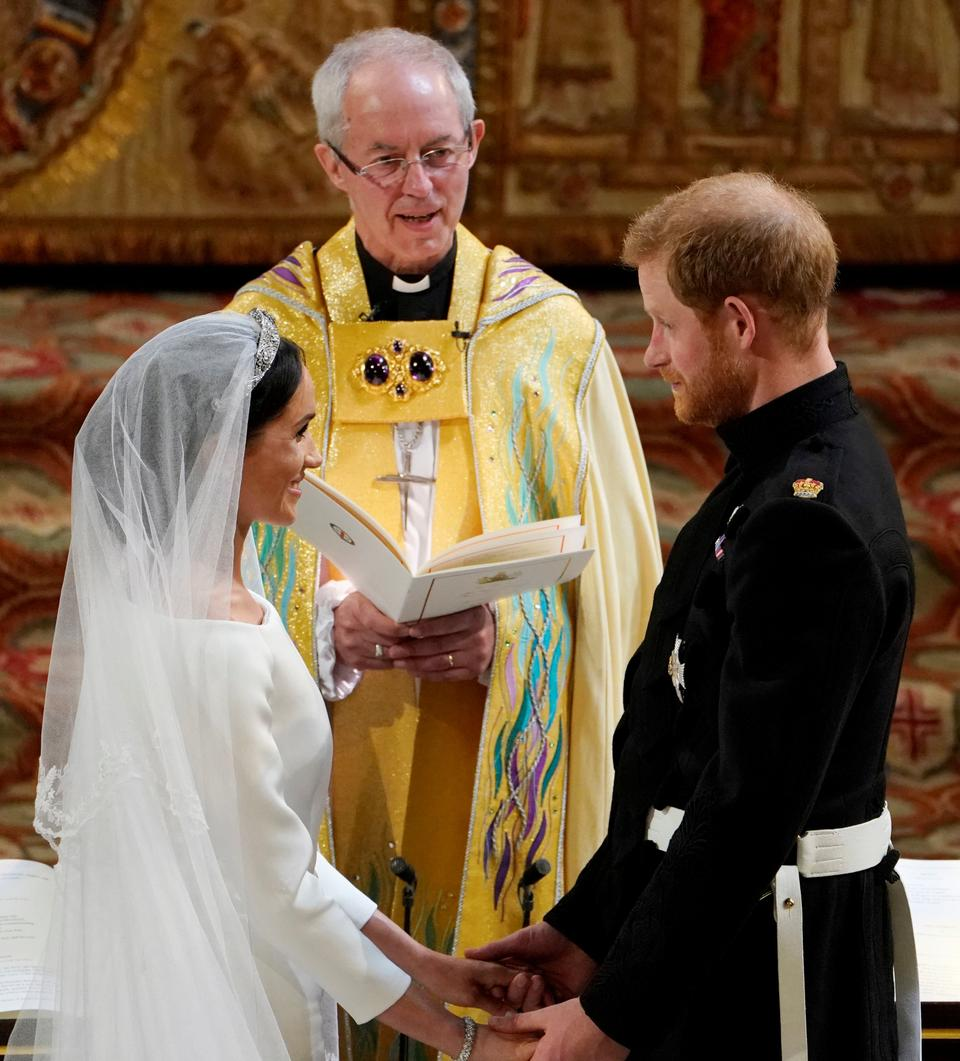 Prince Harry and Meghan Markle exchange vows in St George's Chapel at Windsor Castle during their wedding service, conducted by the Archbishop of Canterbury Justin Welby in Windsor, Britain, on May 19, 2018.