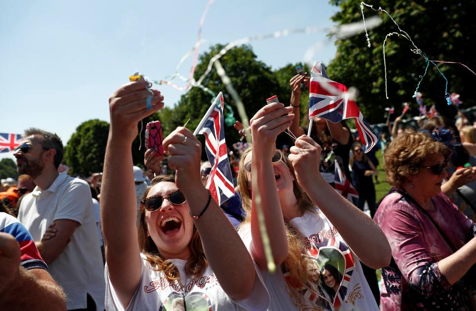 Crowds on the Long Walk in Windsor Great Park cheer when the Royal couple, Prince Harry and Meghan, are pronounced husband and wife in Windsor, Britain, on May 19, 2018.