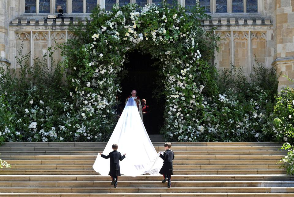 Meghan Markle walks into St George's Chapel at Windsor Castle for her wedding to Prince Harry in Windsor, Britain, on May 19, 2018.