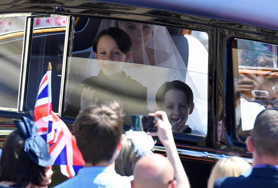 Meghan Markle is driven to St George's Chapel in Windsor Castle along with twin brother page boys John and Brian Mulroney during her wedding to Britain's Prince Harry, in Windsor, Britain, on May 19, 2018.