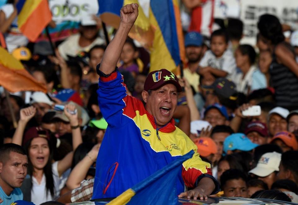 Venezuelan opposition presidential candidate Henry Falcon waves during the closing rally of his campaign ahead of the weekend's presidential election, in Barquisimeto, Lara state, Venezuela on May 17, 2018.