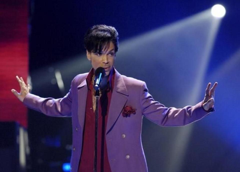 Singer Prince performs in a surprise appearance on the 'American Idol' television show finale at the Kodak Theater in Hollywood, California, US on May 24, 2006.