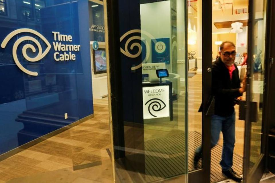 A man exits a Time Warner branch in the Manhattan borough in New York.