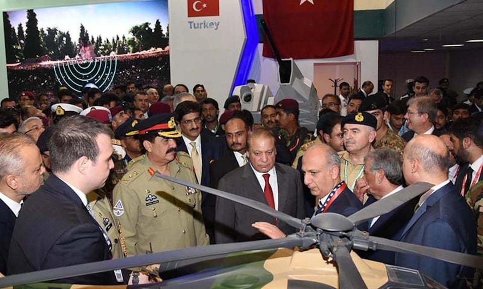 In this November 22, 2016 file photo, A Turkish company's stall is seen behind in the background as Pakistan's then-Prime Minister Nawaz Sharif and then army chief Gen Raheel Sharif visited a defence exhibition in Karachi.