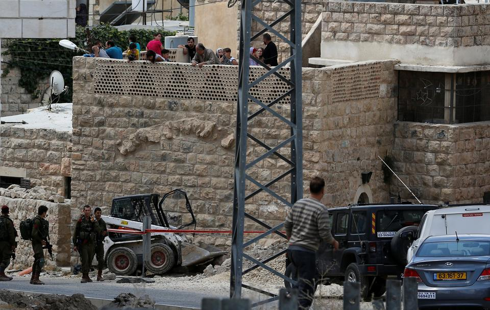 Israeli soldiers stand at the scene of attempted car ramming attack, in Hebron in the occupied West Bank city of Hebron June 2, 2018.