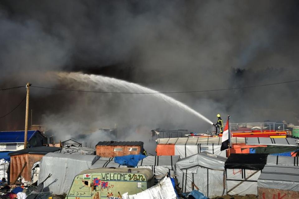 Earlier in the day, riot police took positions around the camp. Fire tenders also arrived to put out blazes that sent plumes of smoke into the sky. (AFP)