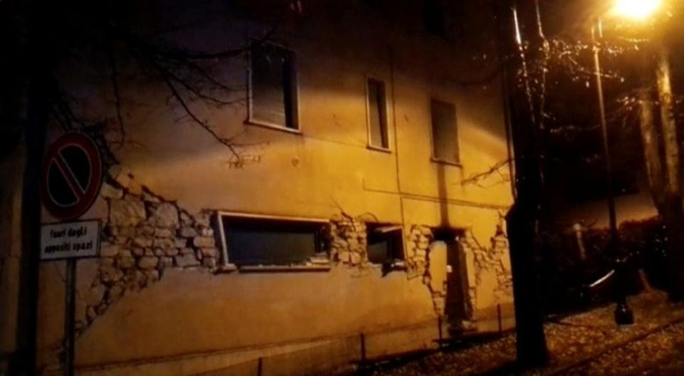 Still image from video shows damaged building after an earthquake in Visso, Italy October 26, 2016. Still image from video shows a man trying to remove rubble from a road after an earthquake in Visso, Italy October 26, 2016. (Reuters)