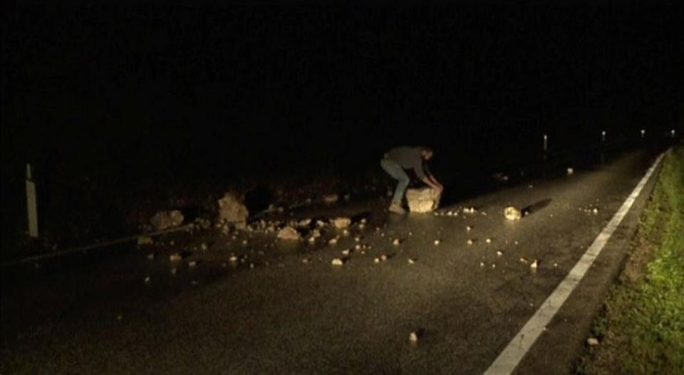 Still image from video shows a man trying to remove rubble from a road after an earthquake in Visso, Italy October 26, 2016. (Reuters)