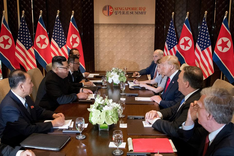 US President Donald Trump (3rd R) and North Korea's leader Kim Jong-un (2nd L) sit down with their respective delegations for the US-North Korea summit, at the Capella Hotel on Sentosa island in Singapore.