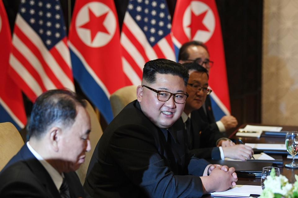 North Korea's leader Kim Jong-un looks on while seated with members of his delegation during the US-North Korea summit with US President Donald Trump (not pictured) at the Capella Hotel on Sentosa island in Singapore.