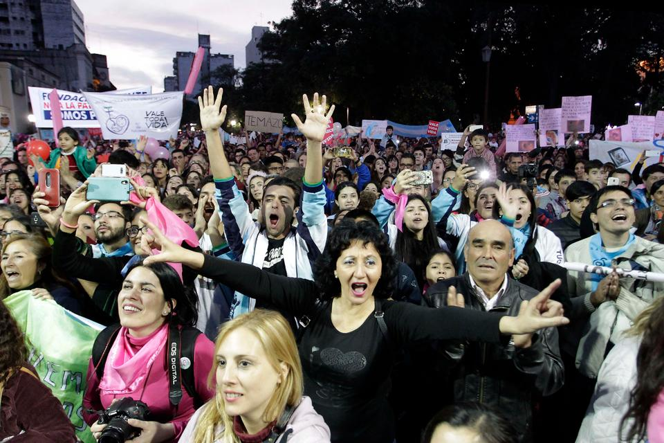 People demonstrate against the decriminalisation of abortion in front of the Cathedral of Tucuman, in northern Argentina, after marching under the slogan