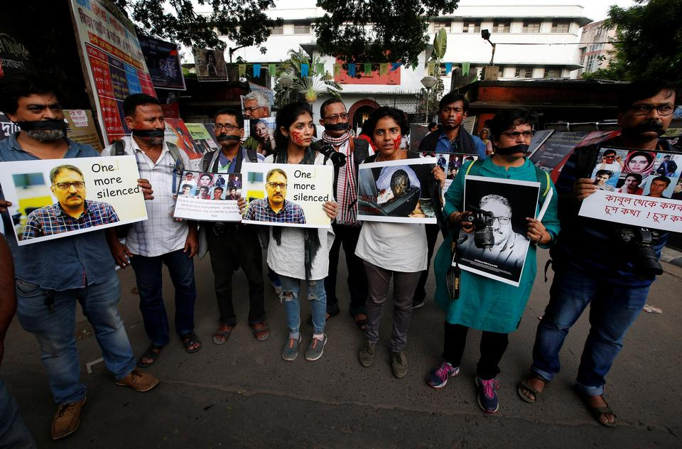 Journalists hold placards during a silent protest against the killing of Syed Shujaat Bukhari, the editor-in-chief of local newspaper