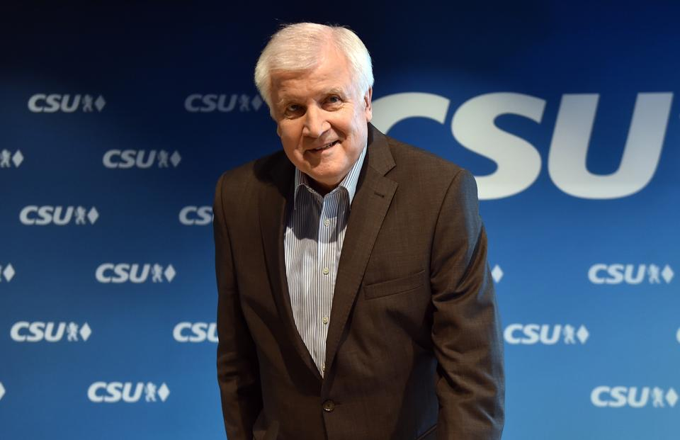 German Interior Minister and leader of the Christian Social Union (CSU) Party Horst Seehofer arrives for a press conference after the party meeting at the CSU headquarters in Munich on June 18 2018. Germany's interior minister vowed to begin turning back migrants at the border by July if Angela Merkel fails to find solutions with European partners, but the chancellor rejected the threat.