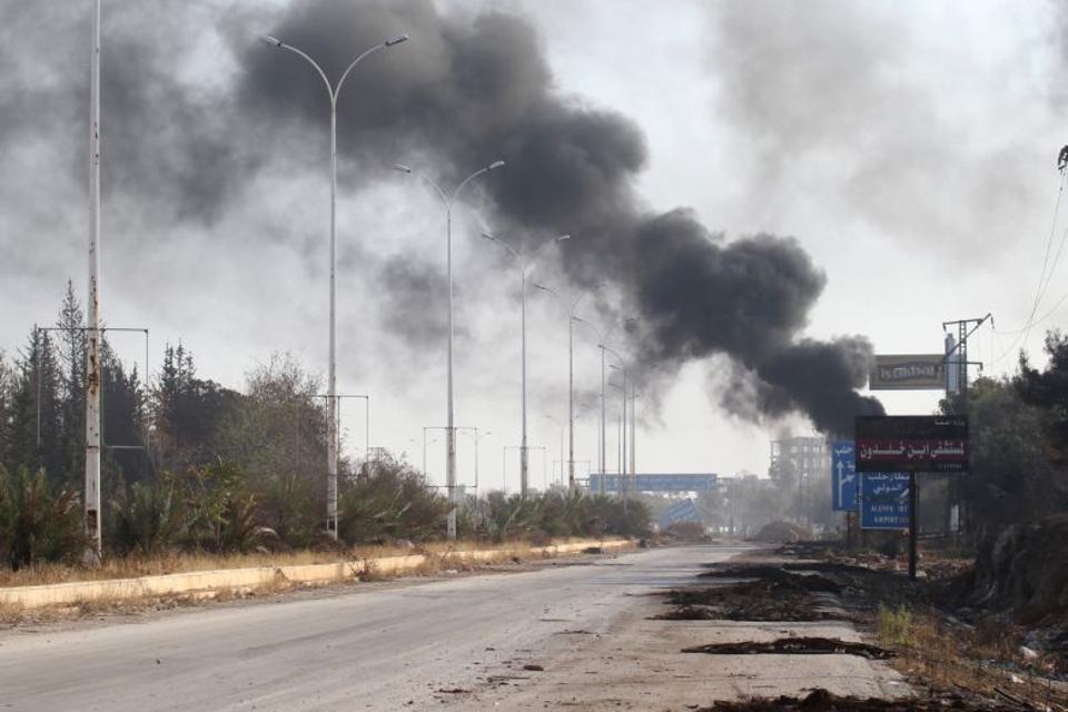 Smoke rises near a damaged road in Dahiyet al-Assad, west Aleppo, Syria October 30, 2016. (Reuters)