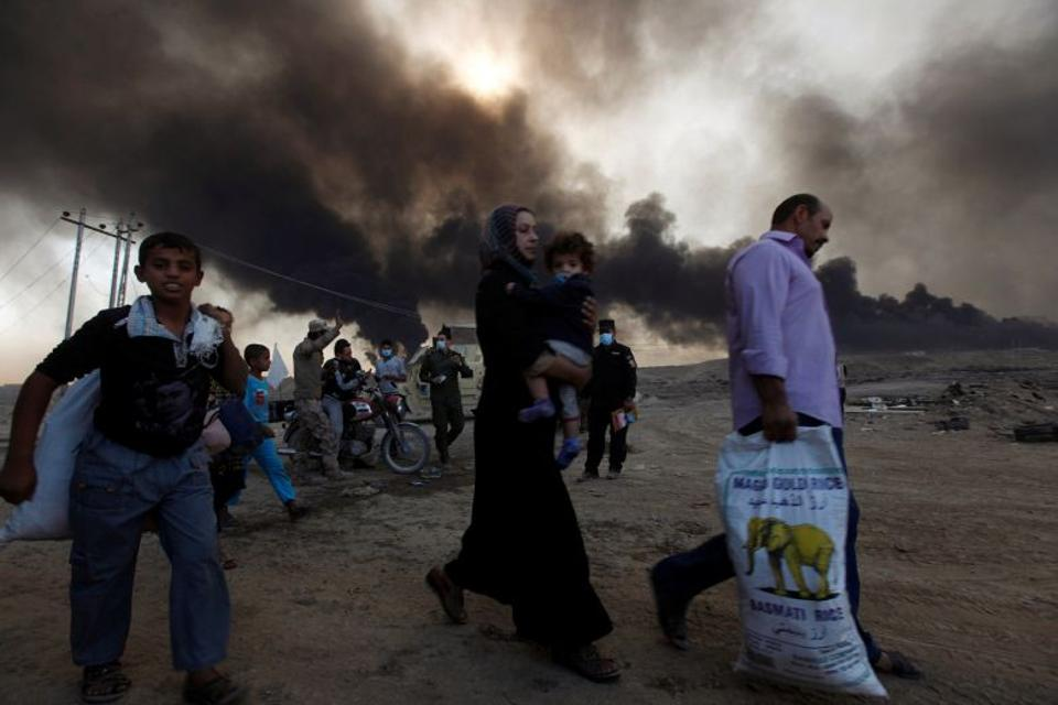 Civilians are returning to their village of Qayyara in the south of Mosul after it was liberated from Daesh. (Reuters)