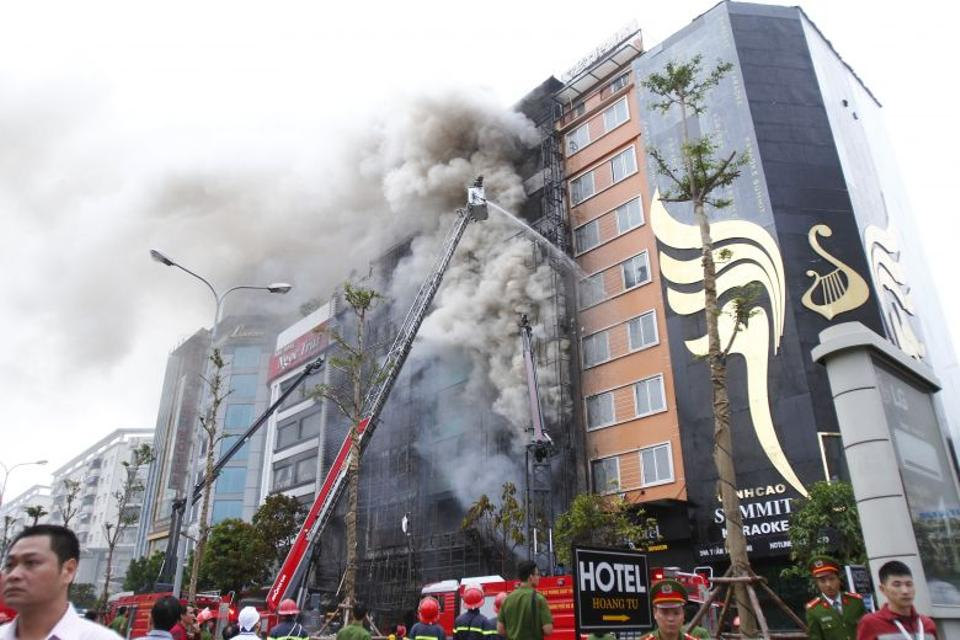 Photos showed plumes of smoke billowing out of the building as firefighters in cranes doused the flames.  (AFP)