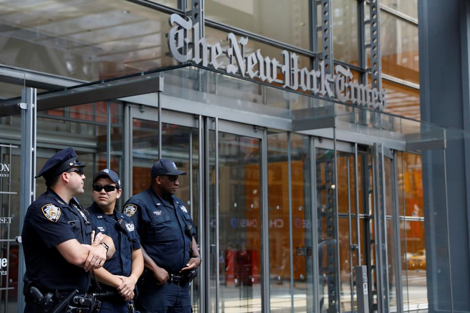 New York Police officers are seen deployed outside the New York Times building, following a fatal shooting at a Maryland newspaper, in New York City, US, June 28, 2018.