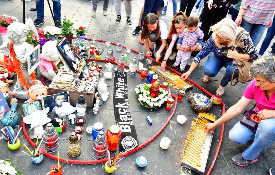 Demonstrators gather near candles and messages in tribute to David Dragicevic in Banja Luka city center, on July 3, 2018 during the 100th day of a demonstration asking for justice for the student found dead in a stream in March.
