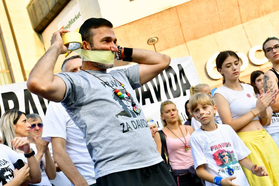 Davor Dragicevic, father of a student found dead in a stream in March, symbolicaly puts duct tape over his mouth during the 100th day of a demonstration asking for justice in Banja Luka city center, on July 3, 2018.