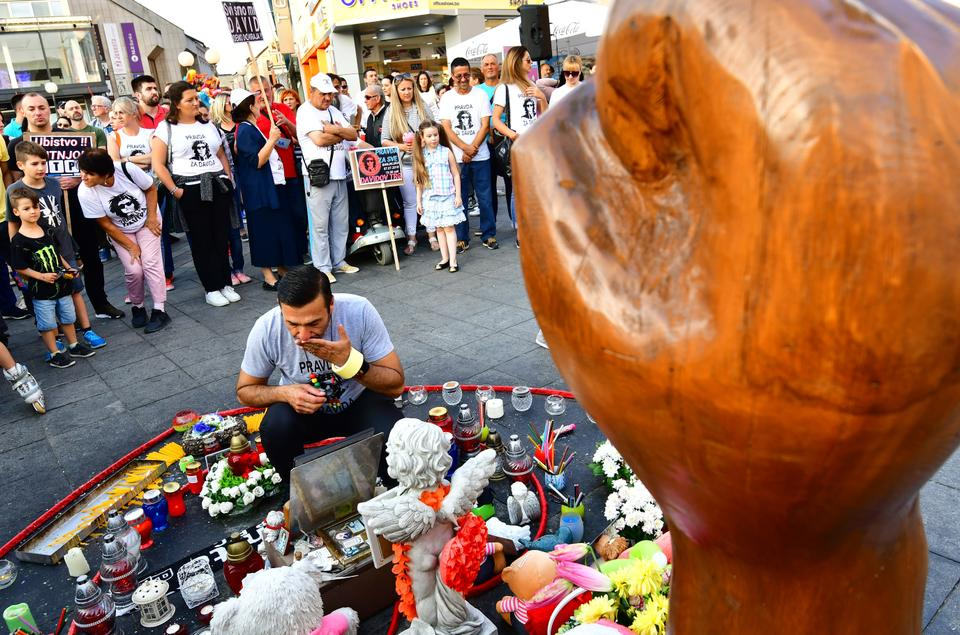 Davor Dragicevic, father of a student found dead in a stream in March, lights a candle for his son during the 100th day of a demonstration asking for justice in Banja Luka city center, on July 3, 2018.