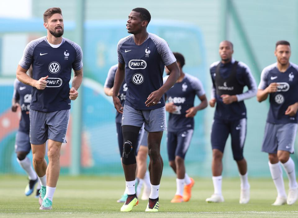 For some people, Olivier Giroud (L) is more French than Paul Pogba whose father came from Guinea.