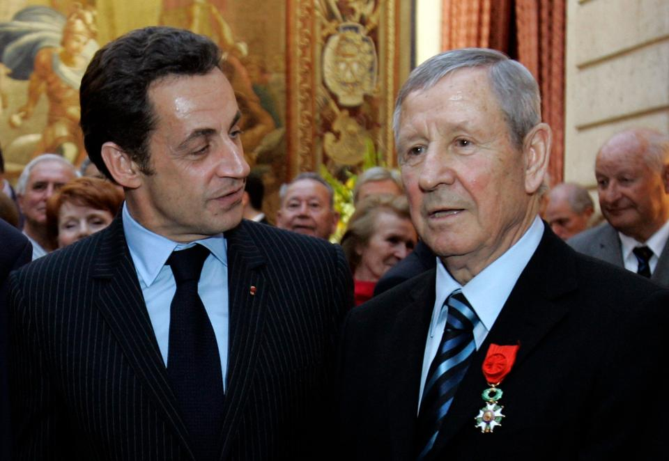 Former French soccer legend Raymond Kopa (R) talks to former French President Nicolas Sarkozy after he was awarded Legion of Honor, France's highest award in 2008.