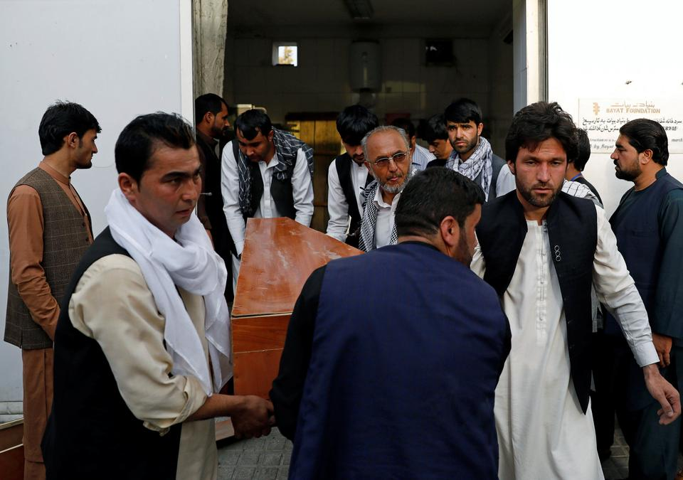 Relatives carry coffin of a victim at a hospital after a blast in Kabul, Afghanistan July 15, 2018