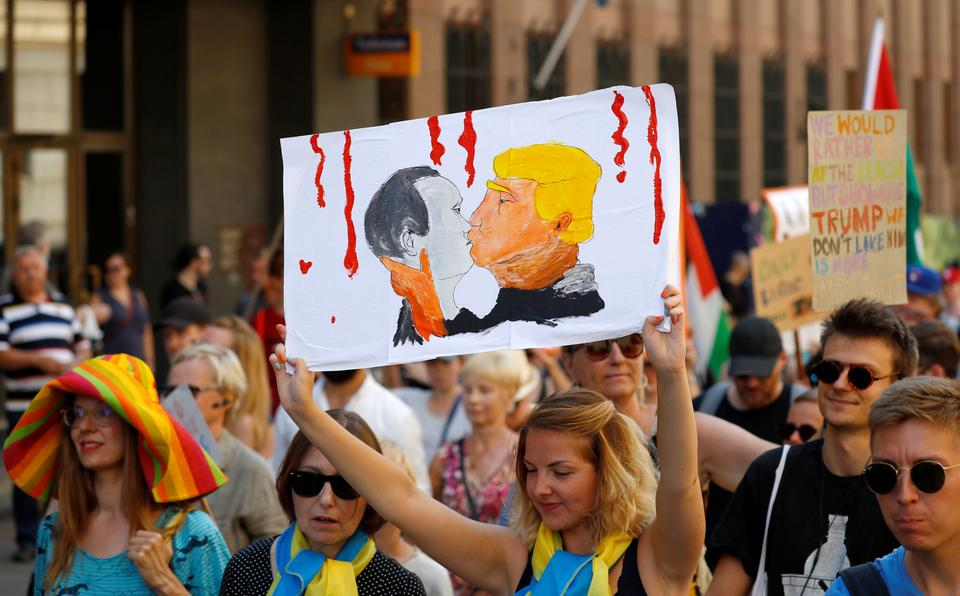 People attend 'Helsinki Calling' protest ahead of Trump-Putin summit.