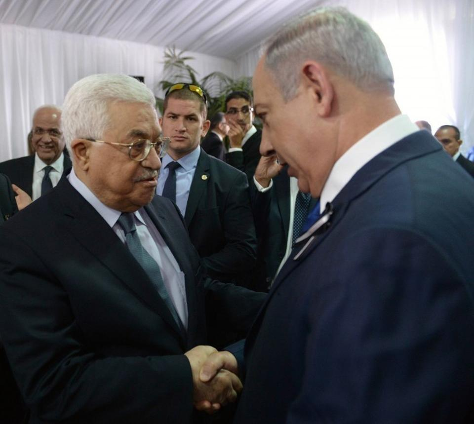 Palestinian President Mahmoud Abbas was critisised for shaking hands with Netanyahu at the funeral of former President Shimon Peres in Jerusalem in September. The two leaders have been at loggerheads in the past over plans for a two-state solution which would see the creation of a Palestinian state. (AP)