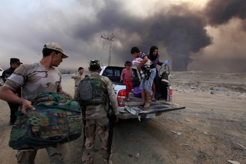 Displaced Iraqis arrive in Qayyarah, south of Mosul, on Oct. 19. More than 54,000 people have been displaced so far in the Mosul campaign. (Reuters)