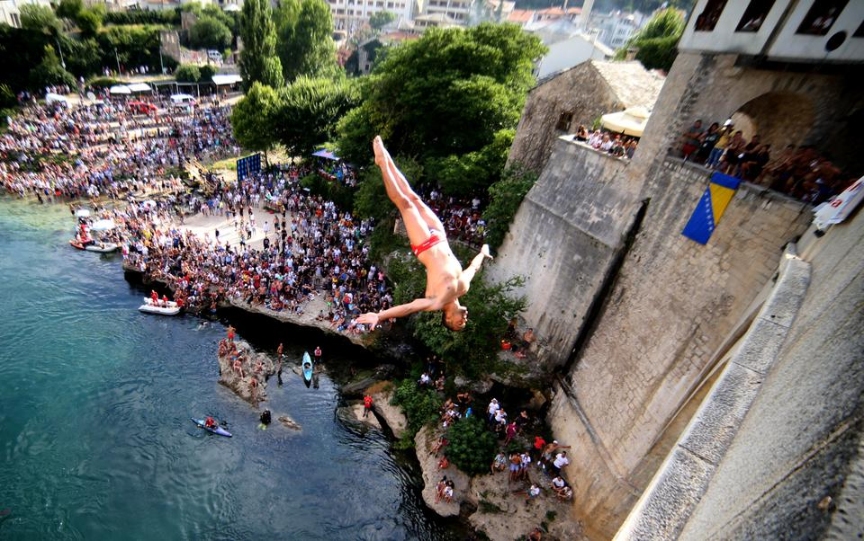 Each summer, a few dozen men enter the contest to take a 79-foot plunge from the bridge into the cold, Neretva River.