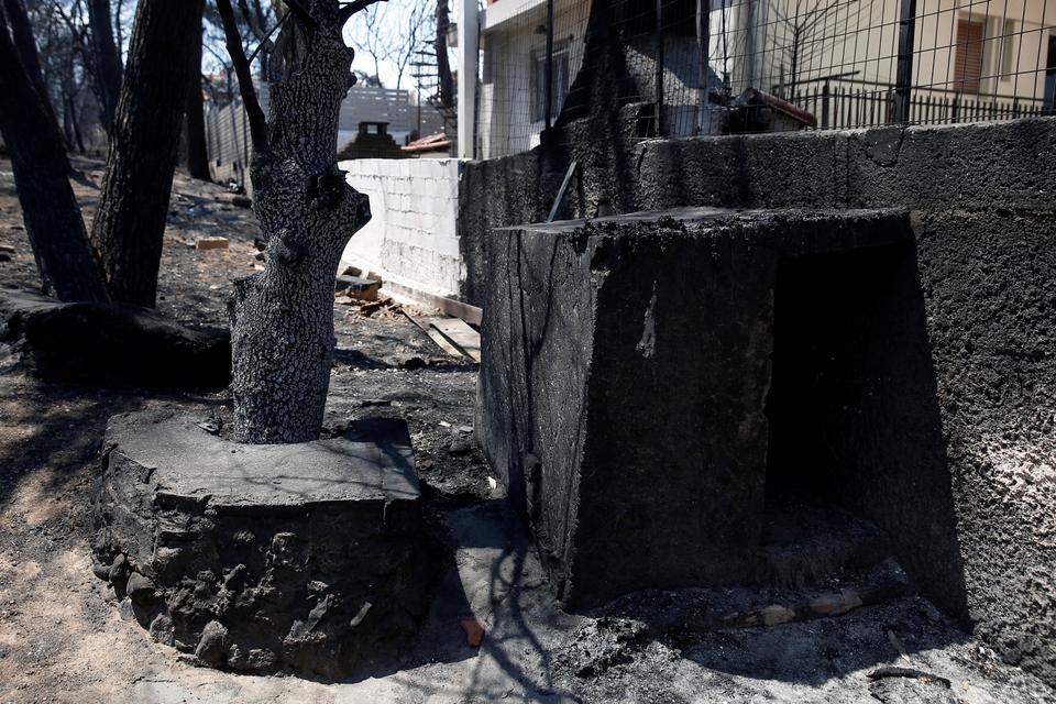The place where Loukoumakis was found, is seen following a wildfire in the village of Mati, near Athens, Greece, July 31, 2018.