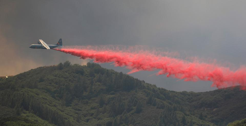 An air tanker drops fire retardant to slow the spread of the River Fire (Mendocino Complex) near Lakeport, California, US. August 1, 2018.