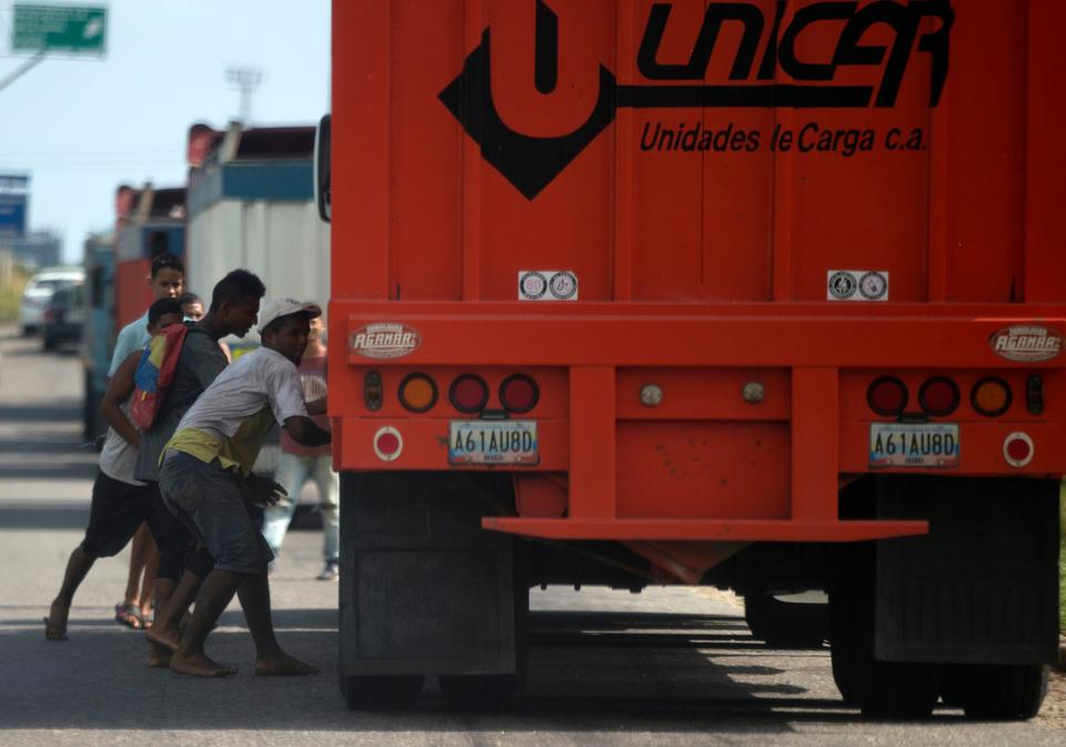 Food shortages in Venezuela have forced people to steal grains and cereals from ration trucks.