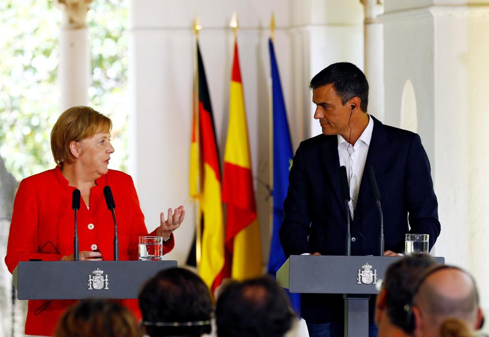 Spain's Prime Minister Pedro Sanchez stands next to German Chancellor Angela Merkel during a joint statement in Sanlucar de Barrameda, Spain on August 11, 2018.